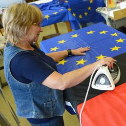 germania-lavoratore-bandiera-corbis-672-351-kZZF--258x258@IlSole24Ore-Web